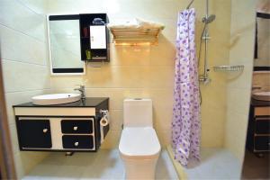 Zhaoxiahong Art hotel, Проживание в семье  Wujiaqiao - big - 260