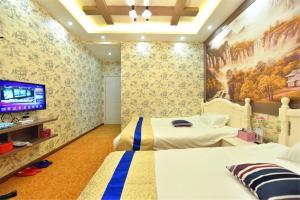 Zhaoxiahong Art hotel, Проживание в семье  Wujiaqiao - big - 245