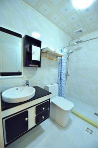 Zhaoxiahong Art hotel, Проживание в семье  Wujiaqiao - big - 241