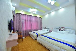 Zhaoxiahong Art hotel, Проживание в семье  Wujiaqiao - big - 239