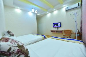 Zhaoxiahong Art hotel, Проживание в семье  Wujiaqiao - big - 237