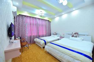Zhaoxiahong Art hotel, Проживание в семье  Wujiaqiao - big - 235