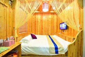 Zhaoxiahong Art hotel, Проживание в семье  Wujiaqiao - big - 222
