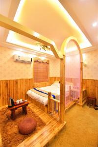 Zhaoxiahong Art hotel, Проживание в семье  Wujiaqiao - big - 220