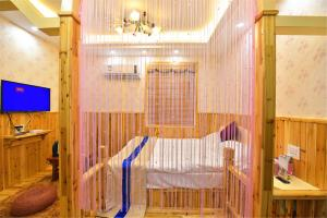 Zhaoxiahong Art hotel, Проживание в семье  Wujiaqiao - big - 214