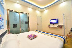 Zhaoxiahong Art hotel, Проживание в семье  Wujiaqiao - big - 203