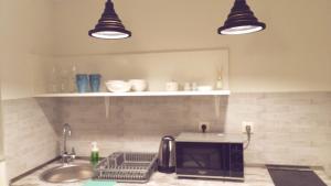 Studio apartment, Apartments  Tbilisi City - big - 26