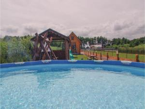 Two-Bedroom Holiday Home in Gaski, Dovolenkové domy  Gąski - big - 14