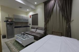 Dorrah Suites, Aparthotels  Riad - big - 7