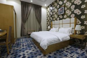 Dorrah Suites, Aparthotels  Riad - big - 13