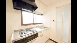 Apartment in Sakuragawa, Apartmanok  Oszaka - big - 17