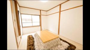 Apartment in Sakuragawa, Apartmanok  Oszaka - big - 16