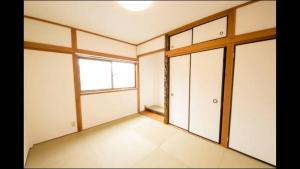 Apartment in Sakuragawa, Apartmanok  Oszaka - big - 15
