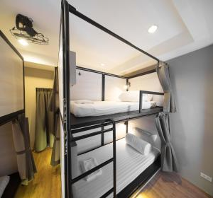 Bunk bed in mixed dorm with a bath room inside
