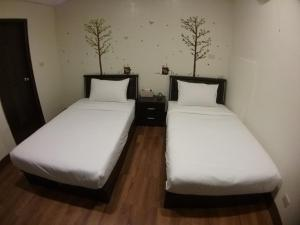 Malaya Guest House, Homestays  Budai - big - 27