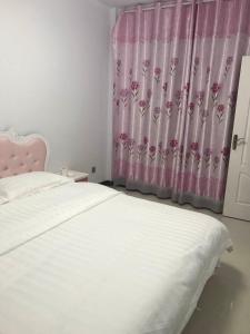 Warm Homeinn Guesthouse, Appartamenti  Dunhuang - big - 2