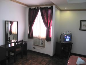 Makati Suites at Travelers Inn, Апарт-отели  Манила - big - 100