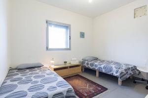 Kfar Saba Center Apartment, Апартаменты  Кфар-Сава - big - 51