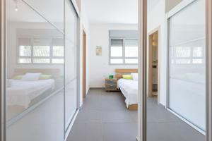 Kfar Saba Center Apartment, Appartamenti  Kefar Sava - big - 56