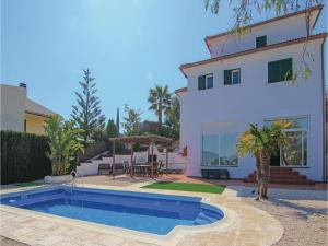 Four-Bedroom Holiday Home in St. Cebria de Vallalta, Nyaralók  San Cipriano de Vallalta - big - 1