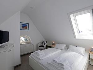 Landhaus Wiesenweg, Case vacanze  Wenningstedt - big - 9