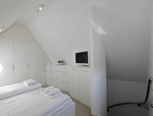 Landhaus Wiesenweg, Case vacanze  Wenningstedt - big - 4