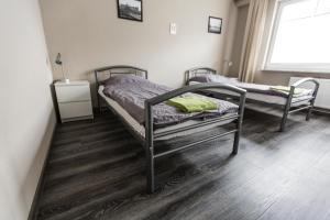 Dreibettzimmer mit Gemeinschaftsbad