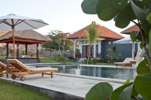 Bali Bule Homestay, Комплексы для отдыха с коттеджами/бунгало  Улувату - big - 6
