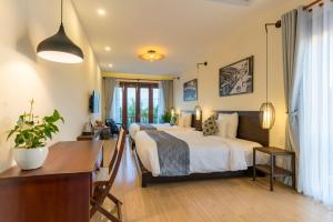 Riverside Hamlet Homestay & Villa, Penzióny  Hoi An - big - 36