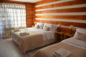 Hostería Casa del Lago, Penziony – hostince  Villa La Angostura - big - 11