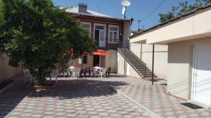 Guest House Granatovoe Derevo, Guest houses  Tbilisi City - big - 1