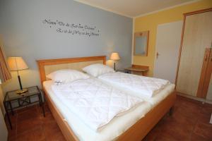 Ferienwohnung Kranichglück, Appartamenti  Neddesitz - big - 8