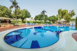 Hotel Holiday International, Отели  Шарджа - big - 54