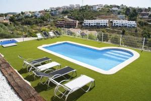 Holiday home Carrer del Puig de Bassegoda, Holiday homes  Calafell - big - 1