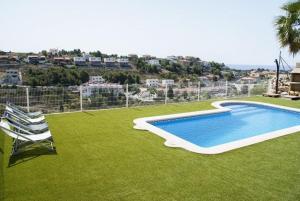 Holiday home Carrer del Puig de Bassegoda, Holiday homes  Calafell - big - 37