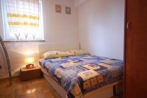 Apartments Tonzi, Ferienwohnungen  Malinska - big - 9