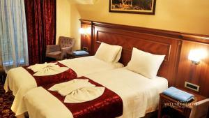 Apartament królewski z 2 łóżkami pojedynczymi