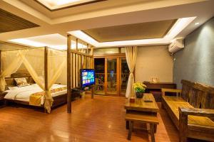 Kongquegu Hostel, Хостелы  Jinghong - big - 11