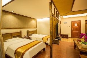Kongquegu Hostel, Хостелы  Jinghong - big - 53