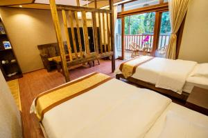 Kongquegu Hostel, Хостелы  Jinghong - big - 49