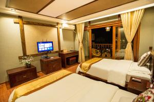 Kongquegu Hostel, Хостелы  Jinghong - big - 35