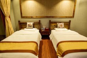 Kongquegu Hostel, Хостелы  Jinghong - big - 33