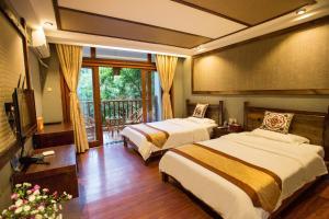 Kongquegu Hostel, Хостелы  Jinghong - big - 25