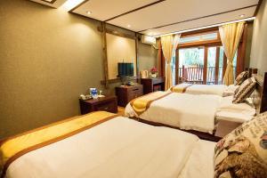 Kongquegu Hostel, Хостелы  Jinghong - big - 23