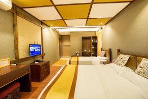Kongquegu Hostel, Хостелы  Jinghong - big - 21