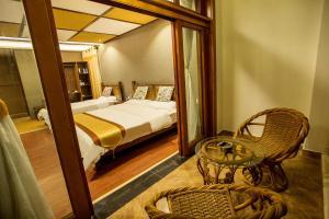 Kongquegu Hostel, Хостелы  Jinghong - big - 19