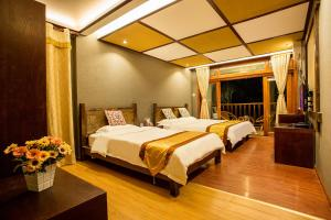 Kongquegu Hostel, Хостелы  Jinghong - big - 17