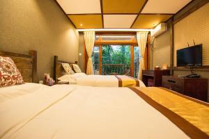 Kongquegu Hostel, Хостелы  Jinghong - big - 16