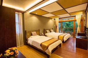 Kongquegu Hostel, Хостелы  Jinghong - big - 62