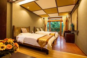 Kongquegu Hostel, Хостелы  Jinghong - big - 14